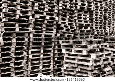 Stack and piles of old transportation and shipping used wood pallets abandoned in bulk in a freight shipment yard