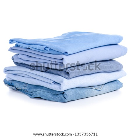 Stack blue clothes and jeans on white background isolation #1337336711