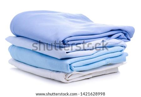Stack blue folded clothing on white background isolation #1421628998