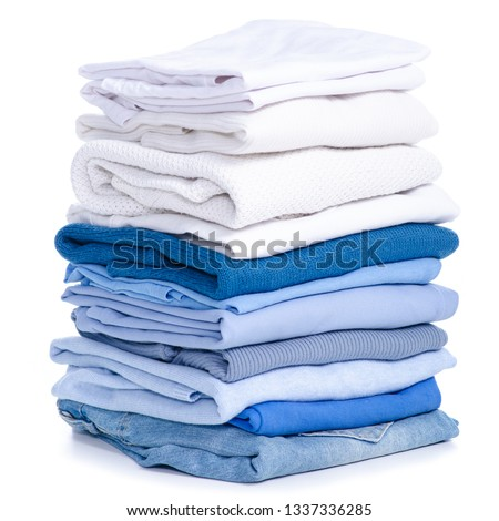 Stack blue jeans and white blue shirt, sweater, t-shirt clothes on white background isolation #1337336285