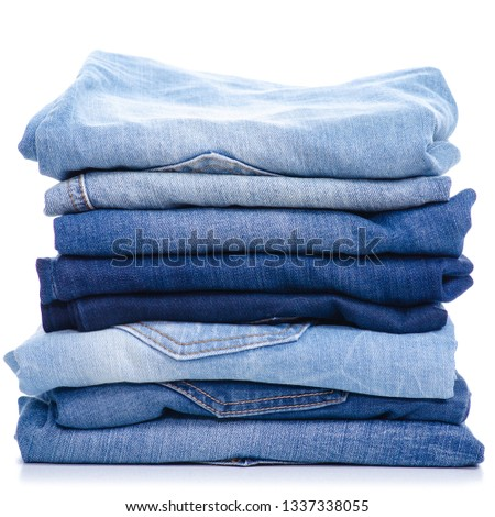 Stack blue jeans on white background isolation #1337338055
