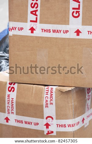 Stack cardboard boxes with \'handle with care\'