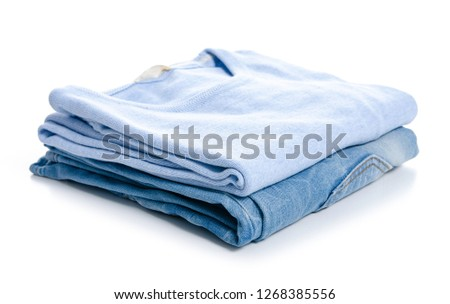 Stack clothing blue jeans and blue sweater on white background isolation  #1268385556