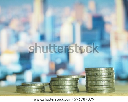 Stack coins with graphic icon  on the city background, Financial concept