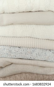 Stock Photo - Stack of cozy knitted sweaters