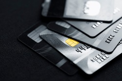 Stack credit cards, close up view with selective focus for background. Online credit card payment for purchases from online shopping.