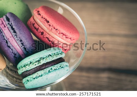 Stack Focus Image Of Colorful French Macarons On Wooden background