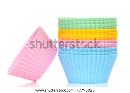 Stack of a variety of colorful cupcake liners in pastel colors