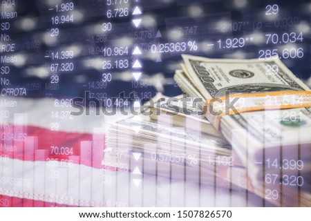 Stack of American dollars on the American flag with an illustration of the financial market