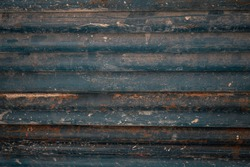 Stack of an old round metal bar with lots of rust and dirt.