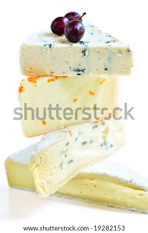 Stack of assorted cheeses isolated on white background