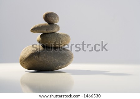 Stack of balanced stones in Zen-like setting