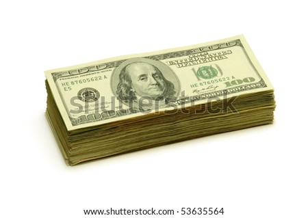 Stack of $100 banknotes on a white surface