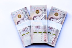stack of 1000 bath Thai money : New Thailand Currency 1000 Bath with the image of Thai King . BankNotes  on white background WITH copy space.