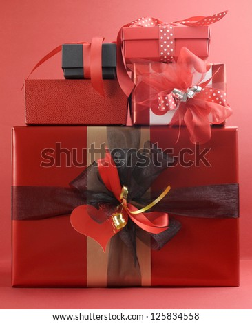 Stack of beautiful red present gifts for Valentine, Christmas, birthday or someone special.
