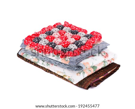 Stack of bedding set with flowers. Isolated on a white background.