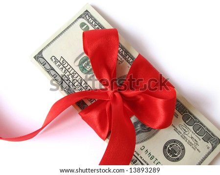 stack of $ 100 bills with red holidays bow