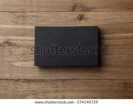 Stack of blank black business cards on wooden background Horizontal #374140729