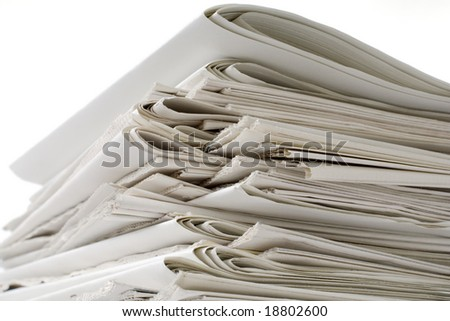 stack of blank newspapers against white - closeup