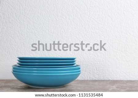 Stack of blue ceramic dishware on table #1131535484