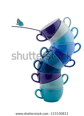 Stack of blue Coffee Cups whit Butterfly isolated on white