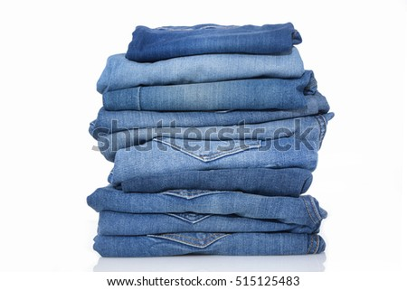Stack of blue jeans  #515125483