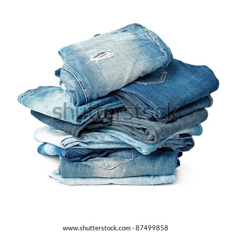 Stack of blue jeans over white