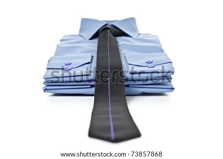 Stack of blue man's shirt and tie - stock photo