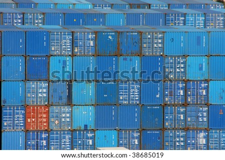 Stack of blue sea containers in an international port  container shipping