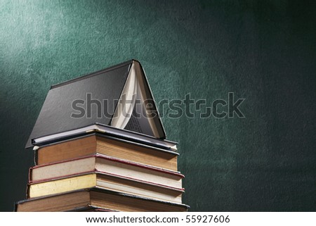 stack of book in front of board