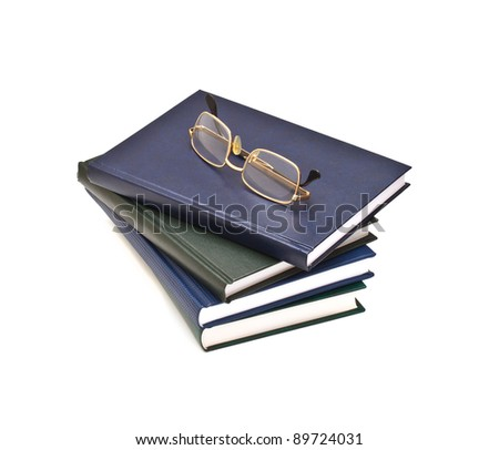 Stack of books and glasses, isolated on white background