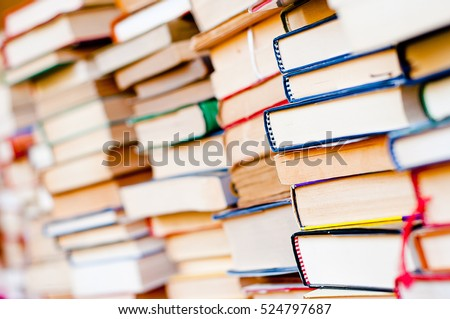 Stack of books background. many books piles. #524797687