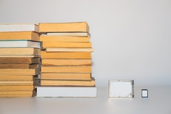 Stack of books, hard disk drive and memory card, development of technology and storing capacity. Storage data, compressed information, digital versus analog concept