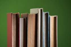 Stack of books isolated on green background