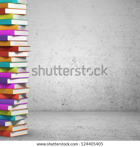 stack of books on concrete background - stock photo