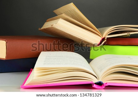 Stack of books on gray background