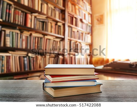 stack of books on table at...