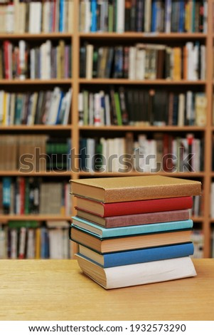 Stack of books on the table in library Foto stock ©