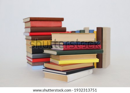 Stack of books on white background Foto stock ©