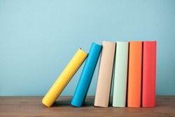Stack of books on wooden table