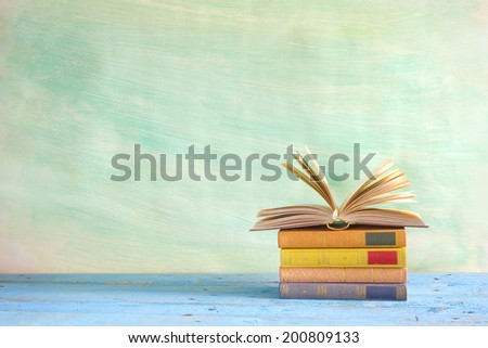 stack of books, one open, grungy background,free copy space