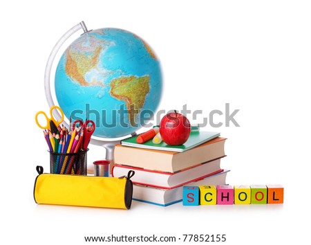 Stack of books, red apple, globe and pencils isolated on white background