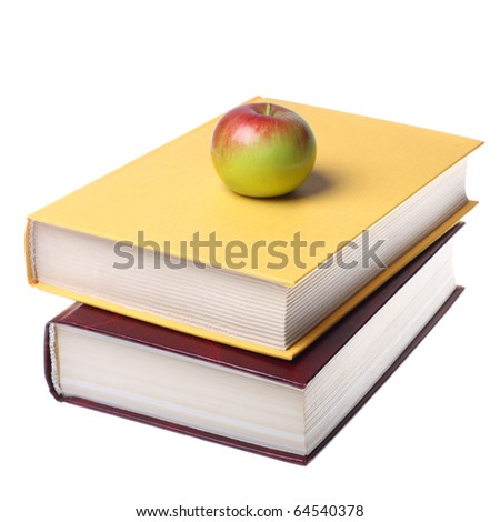 Stack of books with apple isolated on white background