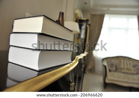 stack of books with classical literature.