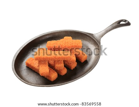 Stack of breaded fish fingers on a pan