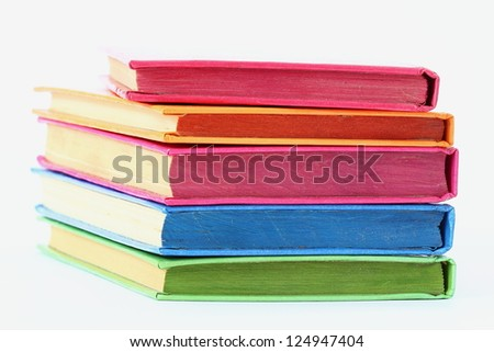 stack of bright books over white
