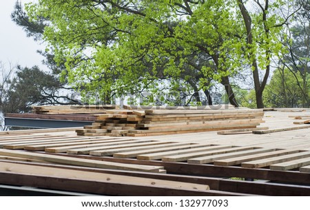 Stack of Building Lumber at Construction Site - stock photo