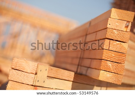 Stack of Building Lumber at Construction Site with Narrow Depth of Field.
