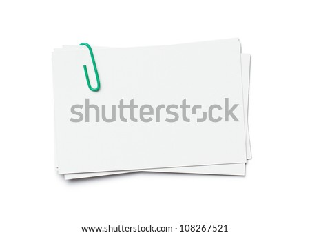 Stack of business cards with paper clip isolated on white background with clipping path