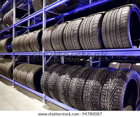 Stack of car tires on warehouse closeup